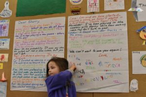 A Miquon Kindergartner shows the letter the class wrote to Sherry in January.